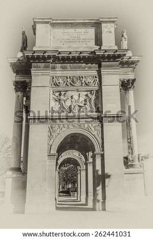 Triumphal Arch (Arc de Triomphe du Carrousel) at Tuileries gardens in Paris, France. Monument was built between 1806 - 1808 to commemorate Napoleon's military victories. Antique vintage.