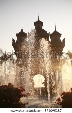 Triumphal arch or Patuxay Monument. The place historical significance of Laos with fountain at daylight. #591095387