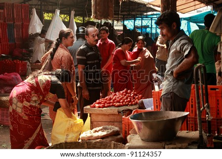 TRIVANDRUM - DEC 02: Local people buy vegetables in a crowded market on December 02, 2011 in Chalai, Trivandrum, India. Chalai is the biggest market in the capital city of Kerala state.