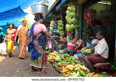 TRIVANDRUM - DEC 02: Unidentified vendor sells vegetables in a crowded  market on December 02, 2011 in Chalai, Trivandrum, India. Chalai is the biggest market in the capital city of Kerala state.