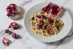 Trofie with radicchio. Autumn dish vegetarian version.