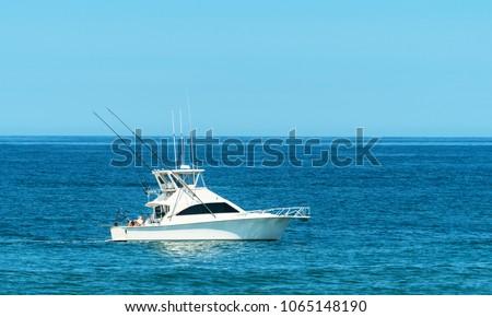 Trolling boat in the ocean. #1065148190