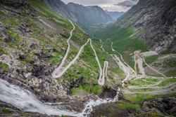Trollstigen, Norway. The world famous curvy road of Trollstigen with a cloudy sky on the background.
