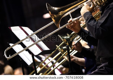 Trombones in the hands of musicians in the orchestra closeup Сток-фото ©