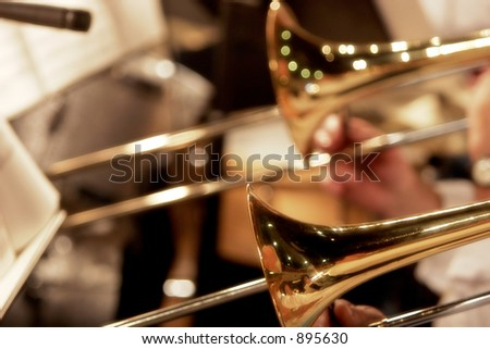 Trombones playing in a big band - shallow focus. - stock photo