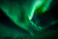 Tromso, Norway - 02 29 2020: northernlights dancing near Tromso at the nightsky
