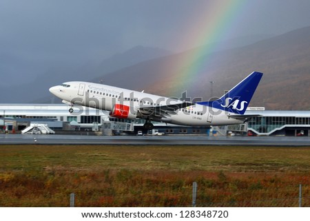 TROMSO, NORWAY - SEPTEMBER 21: A SAS Scandinavian Airlines Boeing 737 takes off on September 21, 2012 in Tromso, Norway. SAS operates with 152 aircraft and carried 22.9 million passengers in 2011.