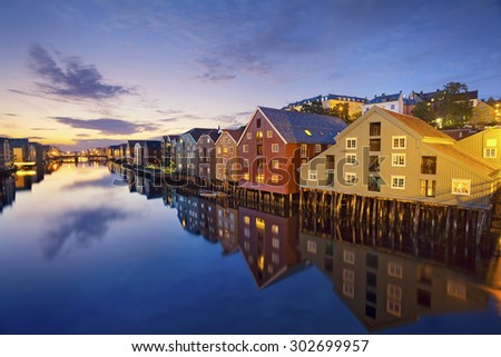 Trondheim. Image of norwegian city of Trondheim during twilight blue hour. #302699957