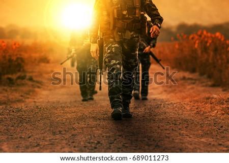 troop with gun weapons of long range patrol army