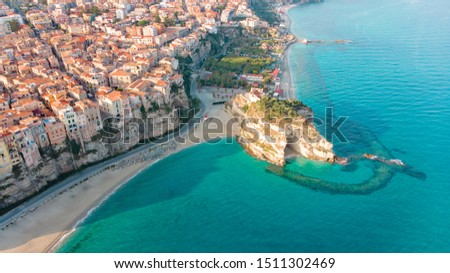 Tropea, Italy - Aerial View of the Italian town, famous touristic destination in Calabria - Monastery and coastline with azure crystal-clear water from drone perspective