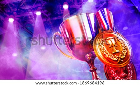 Trophy hang with winner medals and background blue and violet light from spotlight for e-sport winner event.    Photo stock ©