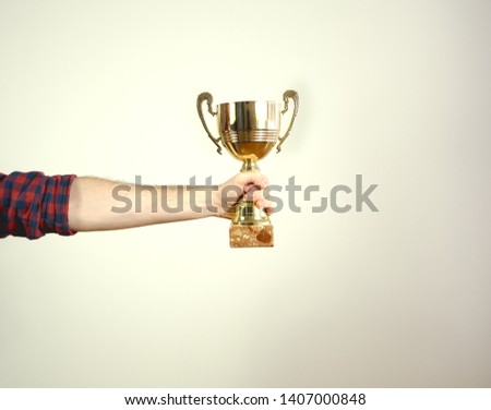Trophy Isolated. Man Holding Trophy #1407000848