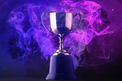 Trophy on smoke on dark blue futuristic background for e-sport winner concept.