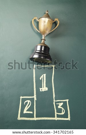 trophy on the blackboard with drawing podium 1,2,3 #341702165