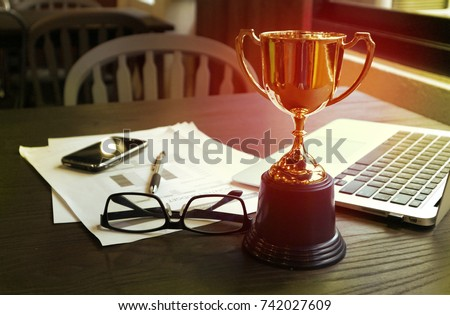 Trophy on work table, win concept #742027609