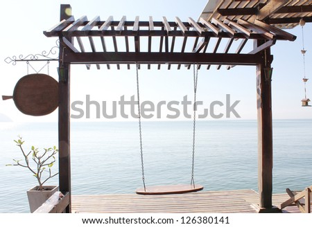 Tropical beach and wood swing