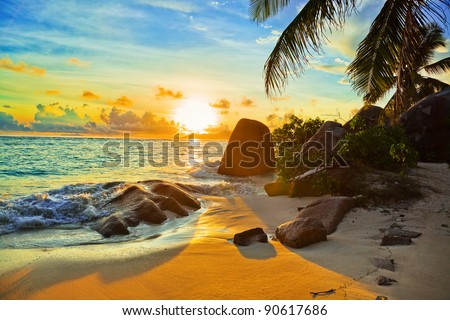 tropical beach at sunset  ...