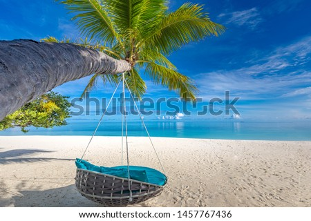 Tropical beach background as summer landscape with beach swing or hammock and white sand and calm sea for beach banner. Tranquil beach scene vacation and summer holiday concept. Boost up color process