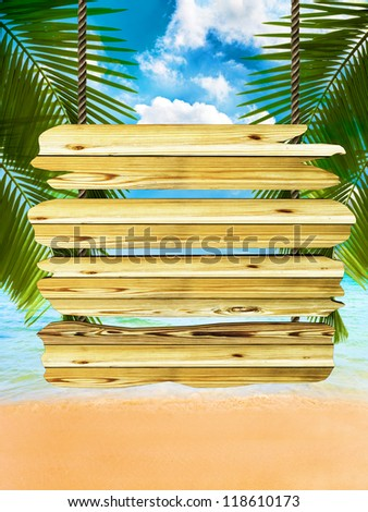 Tropical beach background with exotic wood board sign, room for text or copy space - stock photo