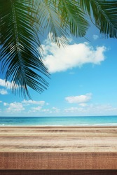 Tropical beach background with palm tree and empty wooden, Summer.