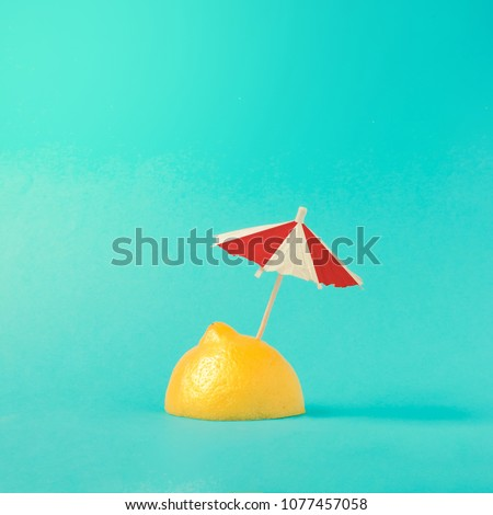Tropical beach concept made of lemon and sun umbrella. Creative minimal summer idea. - Shutterstock ID 1077457058