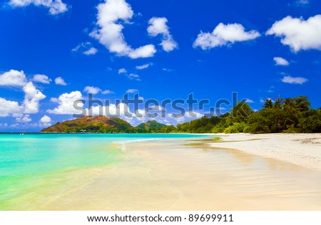 Tropical beach Cote d'Or at island Praslin, Seychelles - vacation background