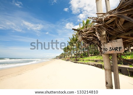 "Tropical beach in Bali Bali, Indonesia. nameplate ""to surf"""