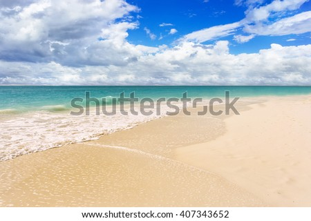 Tropical beach in Caribbean sea, Cayo Largo island, Cuba. Exotic beach nature and clouds on horizon. Summer beach paradise. Tropical island beach. Sea shore line. Island beach relax outdoor landscape