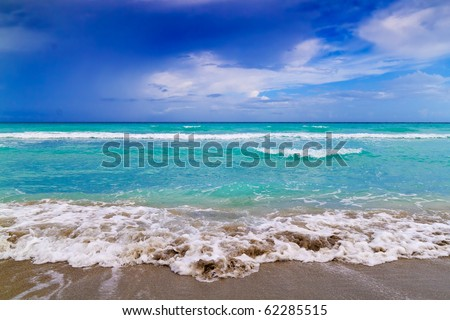 Tropical beach landscape with a dramatic cloudy sky