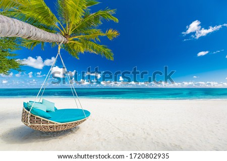 Tropical beach paradise as summer landscape with beach swing or hammock and white sand, calm sea for serene beach. Luxury beach scene vacation summer holiday. Exotic island nature travel destination