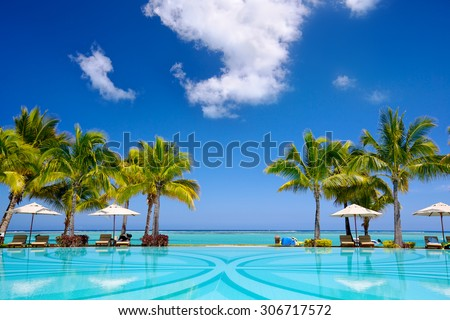 Stock Photo Tropical beach resort with  lounge chairs and umbrellas, Mauritius