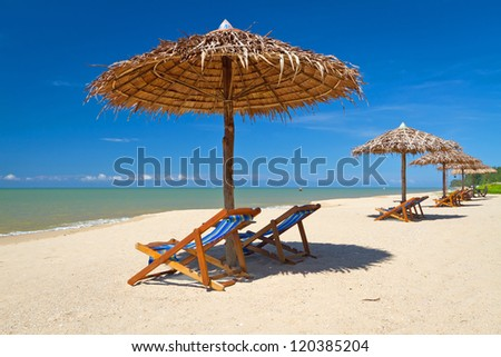 Tropical beach scenery with parasols in Thailand