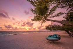 Tropical beach sunset as summer landscape with luxury resort beach swing or hammock and white sand and calm sea for sunset beach landscape. Tranquil beach scenery vacation and summer holiday concept.