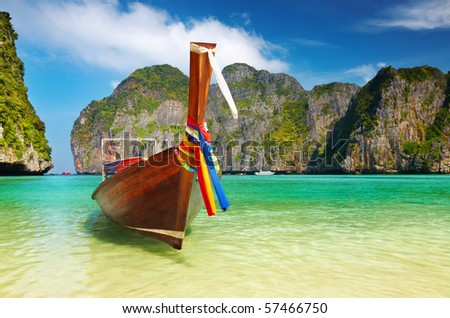 Tropical beach, traditional long tail boat, Maya Bay, Thailand