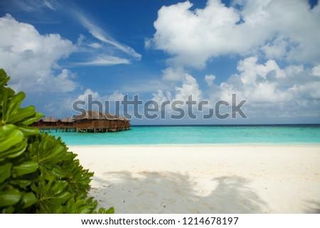 Tropical beach. White sand, blue sky and crystal sea of tropical beach. Ocean beach relax, travel to islands #1214678197