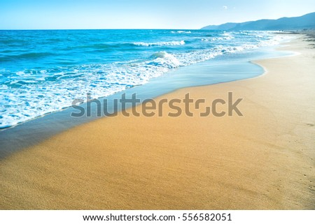 Tropical beach with sand and sea wave at background