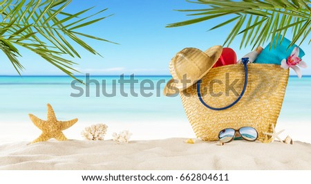 Tropical beach with sunbathing accessories, summer holiday background. Travel and beach vacation, free space for text. #662804611