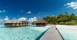 Tropical Beach with Water-Bungalows on the Maldives