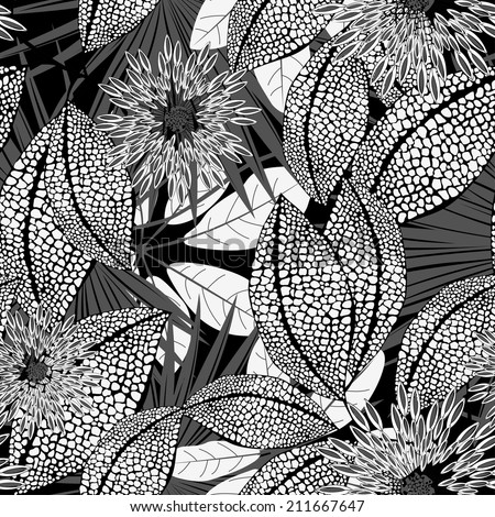 Tropical black and white spotted flowers in a seamless pattern .