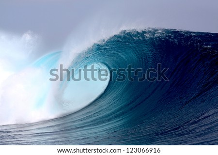 Tropical blue surfing wave - stock photo