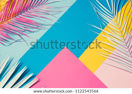 Tropical bright colorful background with exotic painted tropical palm leaves. Minimal fashion summer concept. Flat lay. #1122543566