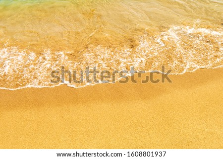 tropical calmness sand seashore covered by transparent blue tranquil sea water
