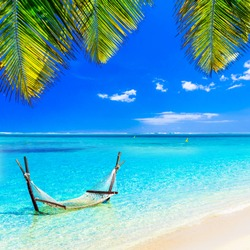 Tropical chilling out - hammock in turquoise water.