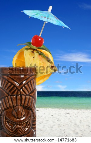 Tropical cocktail closeup with beach background