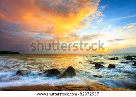 Tropical colorful sunset at the stones beach. Thailand