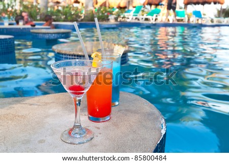 Tropical drinks at swimming pool on holidays