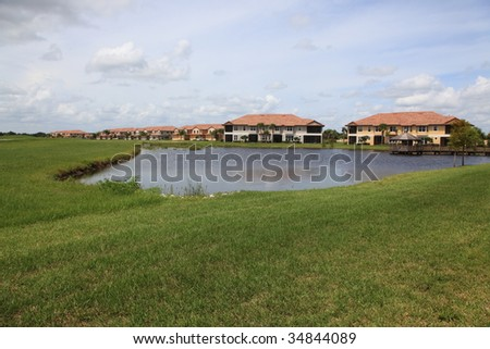 Tropical Florida housing tract with lake