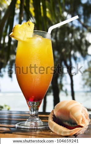 Tropical fruit cocktail and sea shell