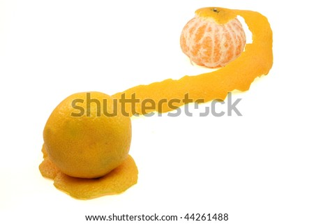 Tropical fruit. Tangerine with the taken off skin on a white background
