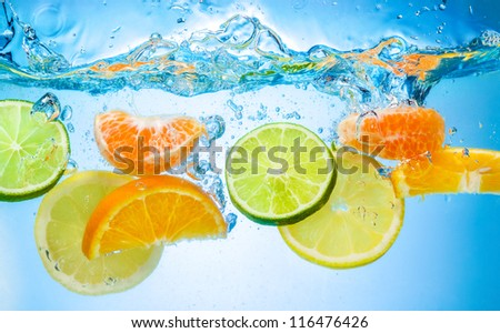 tropical fruits fall deeply under water with a big splash ストックフォト ©